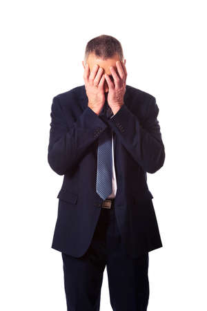 Stressed businessman covering his face with hands