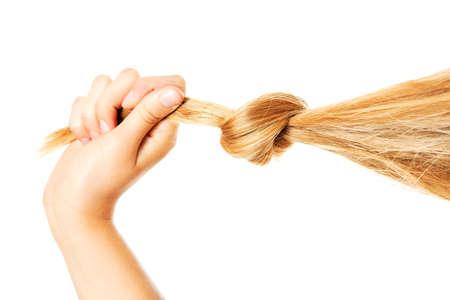 긴 금발 인간의 머리카락 근접, 화이트에 격리. 스톡 콘텐츠 - 83371891