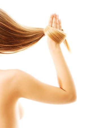 긴 금발 인간의 머리카락 근접, 화이트에 격리. 스톡 콘텐츠 - 83403751