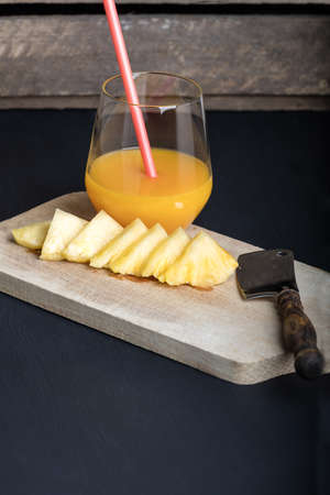 Fresh pineapple and glass with pineapple juice. Reklamní fotografie