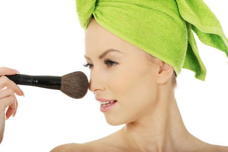 Beauty woman with makeup brush.