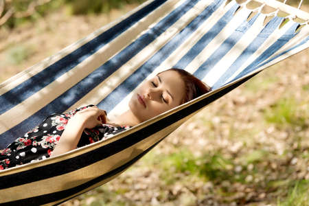 Woman relaxing in the hammock Stock Photo