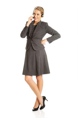Call center woman talking to customer Foto de archivo