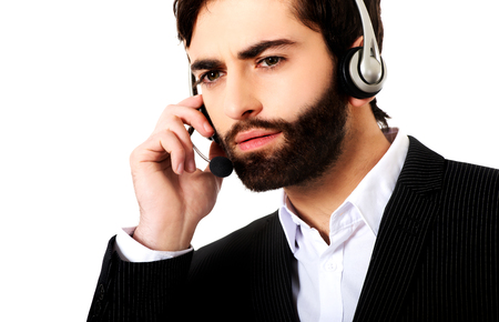 Young call center man talking to customer.