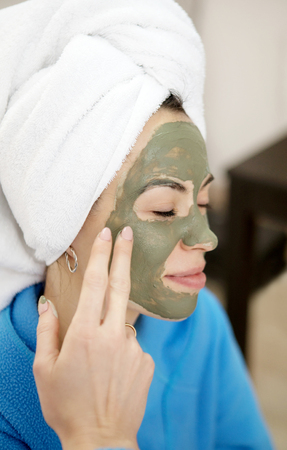 Close-up Portrait of two beautiful looking womans with a facial clay mask.