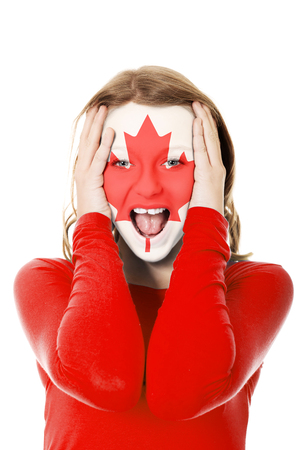 Woman with Canada flag on face.