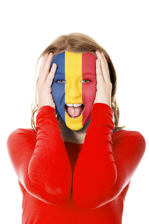 Woman with Romania flag on face. 写真素材