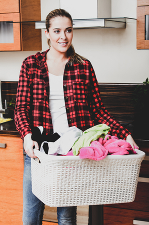 Housekeeper woman with laundry