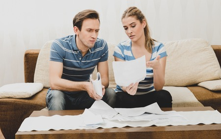 Worried couples with documents