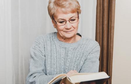 Elderly woman reading book Stock Photo