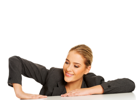 Businesswoman putting hand on desk