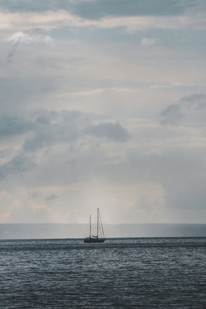 Sailboat on sea in day