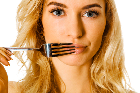 Woman with fork on lips Standard-Bild - 127485324