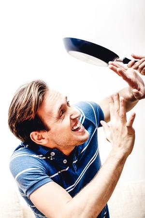 Beating man by pan Standard-Bild - 127485431