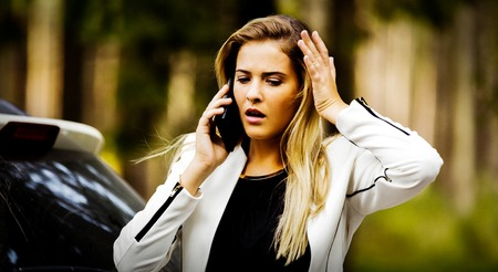 Woman calling to report car accident on the road Standard-Bild - 127495973