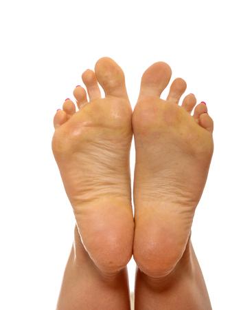 Female a feet on white Standard-Bild - 127496051