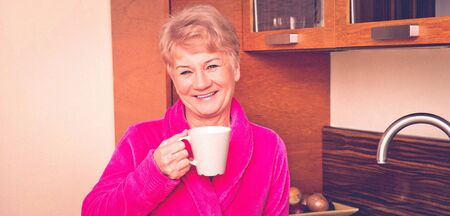 Senior woman with cup of coffee Standard-Bild - 128568251