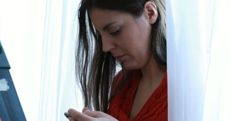 Texting or looking someting on smartphone 版權商用圖片
