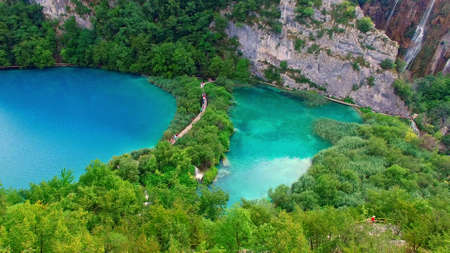 Peaople on board walk of Plitvice Lakes in Croatia.
