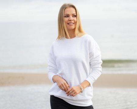 Woman wears white blouse