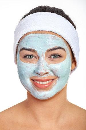 Woman with green cosmetic facial mask 版權商用圖片