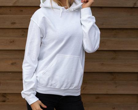 Woman is posing in white hoodie
