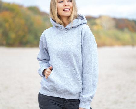 Woman wear hoodie on the beach