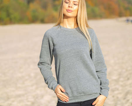 Woman in grey hoodie, casual outfit