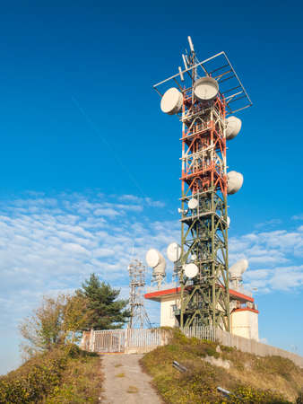 transmitting device: A broadcast relay station for television and radio broadcasting on the summit of mount Fasce, near Genoa Editorial