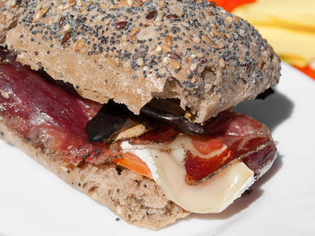 speck: Sandwich with speck, brie, and aubergine Stock Photo