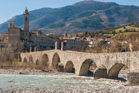 The medieval bridge of Bobbio, a small medieval town in the north of Italy Stock Photo