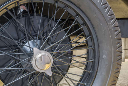 antiquary: Close-up of the wheel of an old automobile