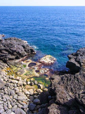 catania: Black coastline with lava cliffs in Catania