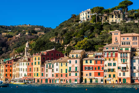 touristic: The waterfront of Portofino with its typical colored houses Stock Photo