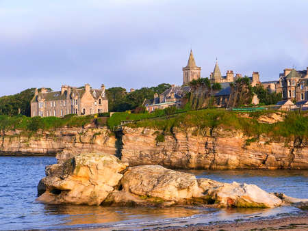 Coastline in St. Andrews with rocky cliffs during the golden hour
