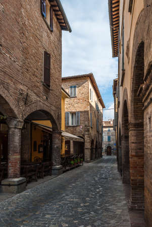 urbino: Narrow street with cobbles in the small medieval town of Urbania Marche region, Italy Stock Photo