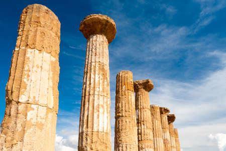 agrigento: Doric columns of the Heracles temple in Agrigento with blue sky and clouds in background