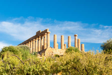 valley of the temples: The greek temple of Juno behind almond trees in the Valley of the Temples of Agrigento Stock Photo
