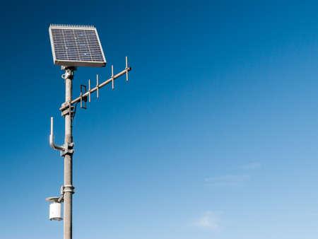 Environmental sensor with antenna and solar panel