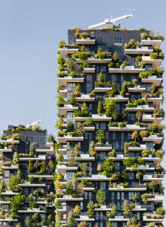 sustainable design: Milan Italy, 19 September 2015: Bosco Verticale Vertical Forest is a pair of two residential towers in the district of Porta Nuova, Milan; they host hundreds of trees and plants in the balconies. Editorial