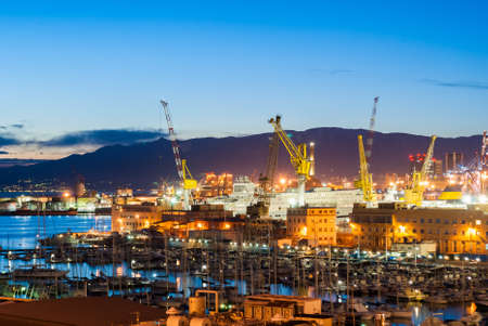 a nocturne: Harbor of Genoa in the evening Editorial