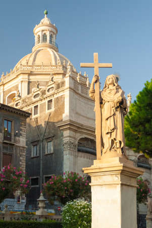 santagata: Statue of Virgin Mary in Catania with a church in the background Stock Photo