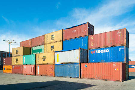 catania: Catania, Italy - 8 February 2015: Stacked colored containers at the harbor of Catania