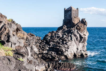 watchtower: Watchtower on a lava cliff near Acireale