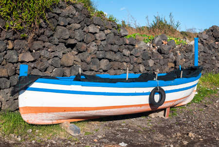 aground: Small fishing boat aground during the winter near Catania (Sicily) Stock Photo