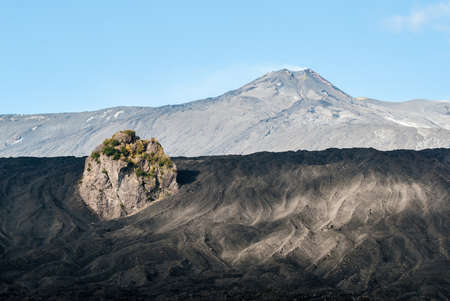Summit craters of volcano Etna seen from the eastern flank