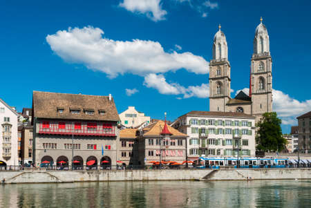 grossmunster cathedral: Skyline of Zurich with the river Limmat in the foreground