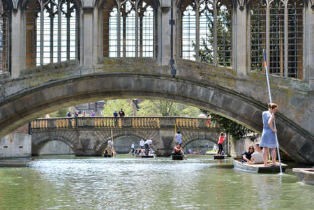 punting: CAMBRIDGE, ENGLAND - 5 May 2013: People punting in the river Cam in Cambridge