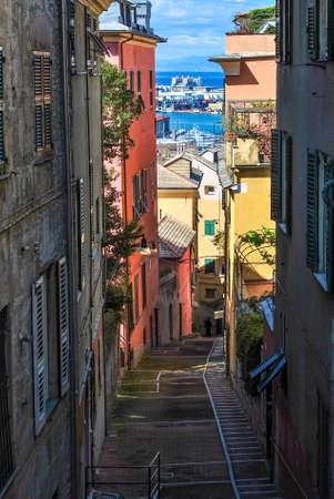 Narrow steep alley in the city center of Genoa Stock Photo