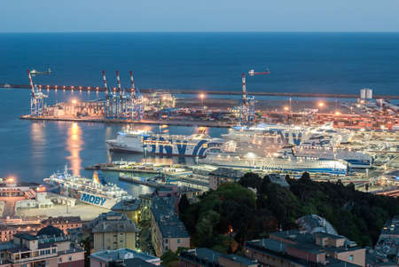 ferries: Ferries moored at the harbor of Genoa in the evening